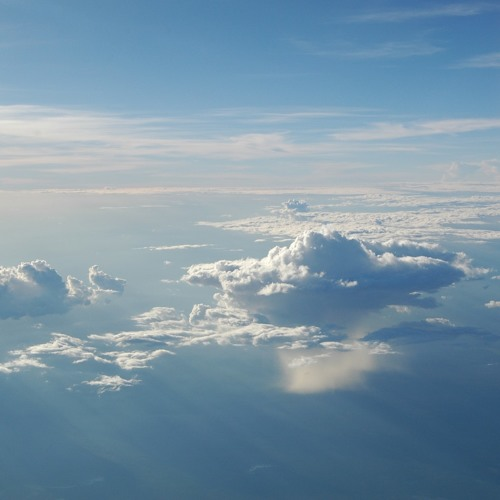 Diving in the clouds over a calm sea