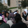 The Mount of Olives: Asian Christians Singing Hymn with Muezzin's Call to Prayer in Background