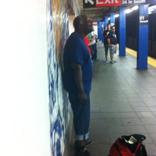 Singer (street performer) at Subway station, Central Park West & 79th St