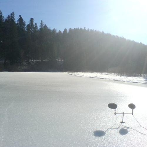 Ice crackling, creaking, singing on a frozen lake