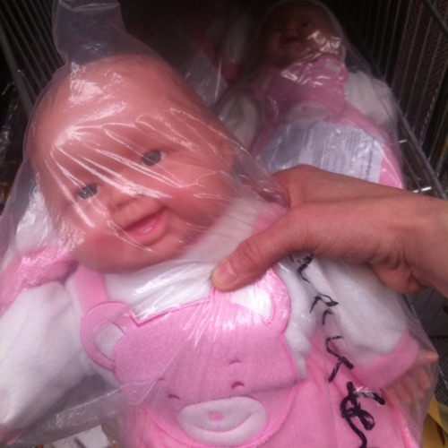 Laughing baby doll at Dong Xuan Center