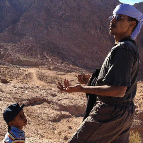 Our guide talking about taking his son up the mountain for the first time at Mt Sinai