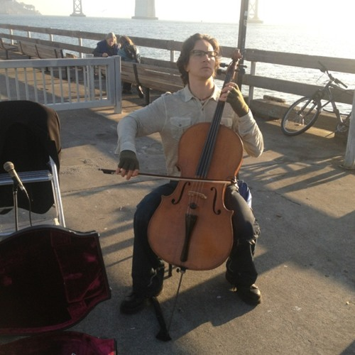 Cello street player by the bay  at Golden Gate San Francisco Ferry Terminal