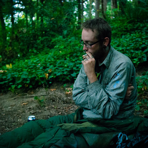 Puke smokes a cigarette in a park in oregon in the morning.  Photo by Jeff Emtman