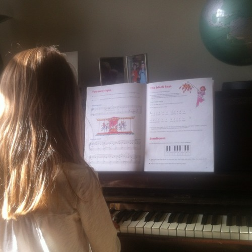 Jemima playing Merry Go Round on piano  at Orwell