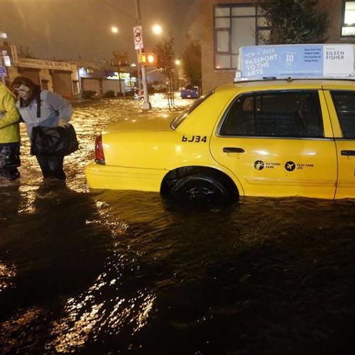Sandy met la campagne entre parenthèses