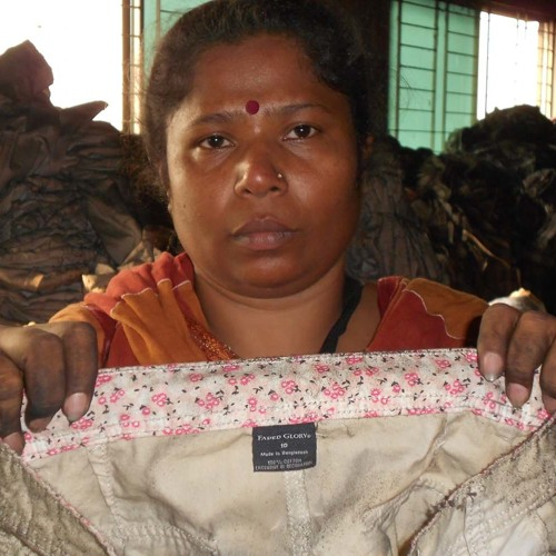 Bangladeshi Labor Activist Finds Burned Wal-Mart Clothes At Deadly Factory Fire 1 of 2