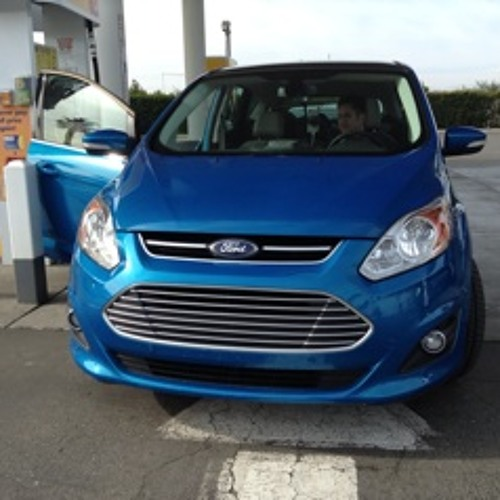 Two Prius owners rate the new Ford C-Max on the way to CES. Listen in...