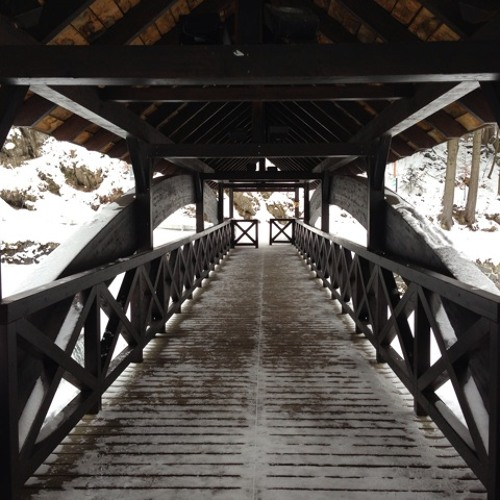 frozen waterfall heard from covered wooden bridge at Špindlerův Mlýn