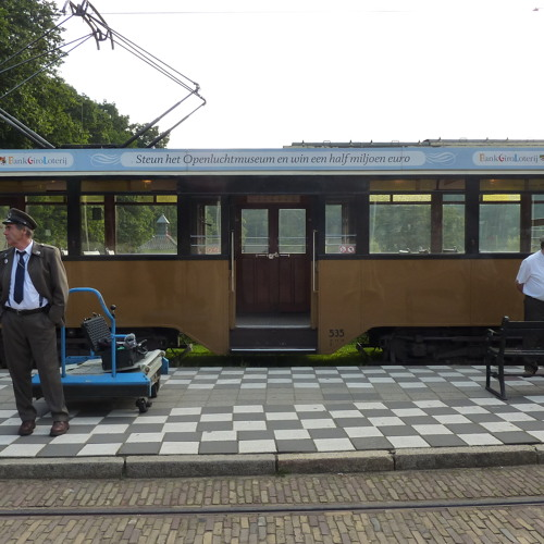Electric streetcar pass by interrupted by monkeys from the Burgers Zoo