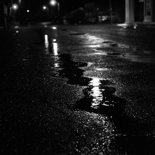 Whisper in falling rain at night