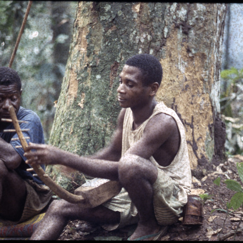 Mamadu playing geedal at night in the rain (Central African Republic, 1993)  [1997 21 2 79 A 2]