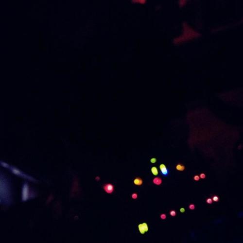 below the DJ booth charging my phone at ETG (Electric Tea Garden)