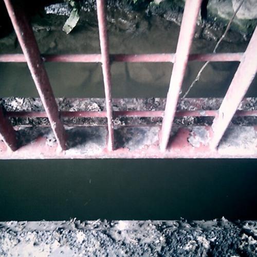 River towpath splashing water under bridge