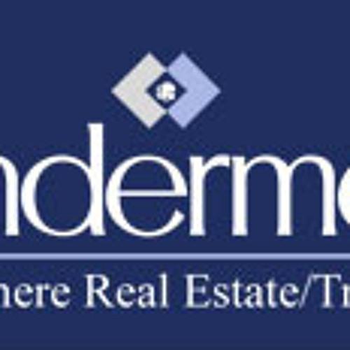 Windermere CEO Joan Tate Allen and real estate agent Roger Gantz