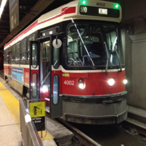 Streetcar entering a station, then approaching and stopping sound fx