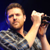 Does CHRIS YOUNG sing along with his own songs?? HE tells me.