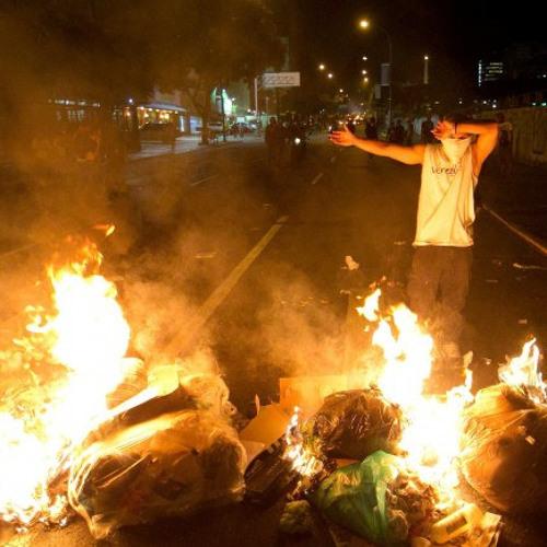 Cracking Down on Protests in Venezuela & Police Corruption in El Salvador (Lp5162014)