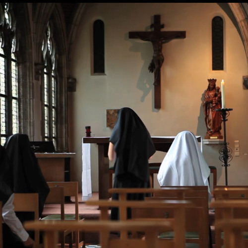 "Some people praying into the ""Abbaye de La Cambre"" in Brussels (Belgium)"