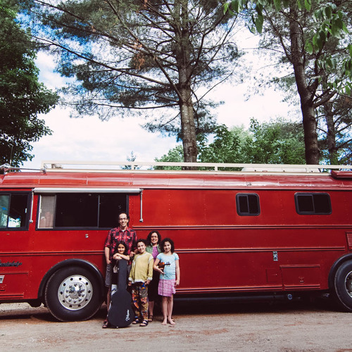 A Quebecois couple educates their children by travelling around the world in a bus