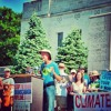 Great Climate Marchers sing at the steps of the capital in Lincoln, NE
