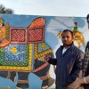 Rj Nihal taking the interview of faculty Jeevan sir(event-wall painting)