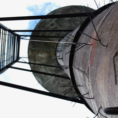 water tower with aeolian wind harp