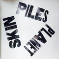 Piles – Planet Skin