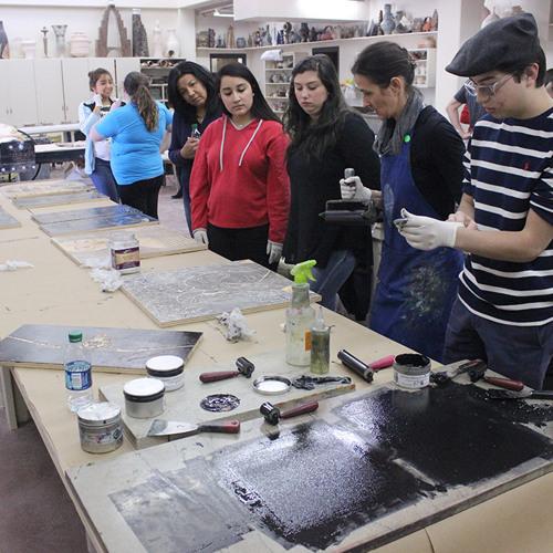 Local art students create steamroller art