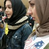 Muslim protesters wears yellow stars at Donald Trump rally