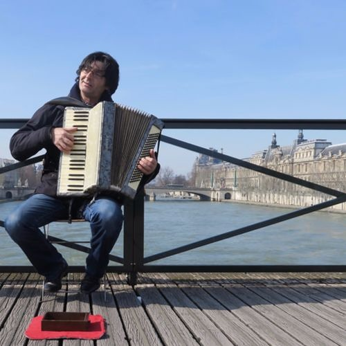 Autumn Leaves by accordion player on the Pont Neuf, Paris, France