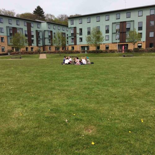 Katerina Talianni Sitting On Grass