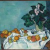 Still Life with Apples and a Pot of Primroses by Paul Cezanne