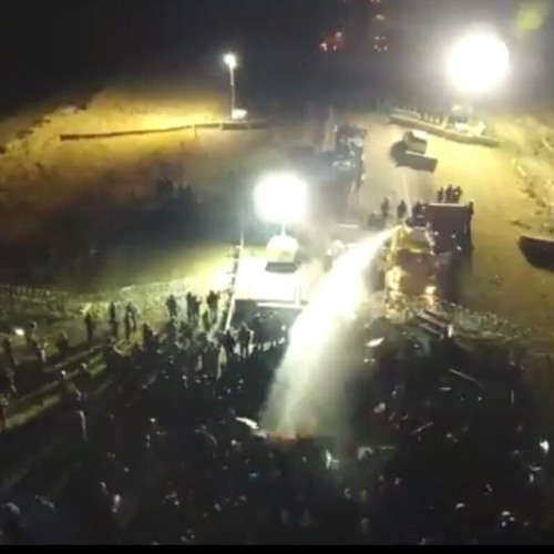 11/20 Water Cannon used on #NoDAPL Protectors - Phone Interview with Angela Bibens