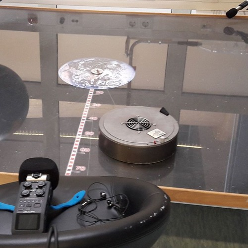 Simulating satellite orbits with a hovercraft model