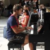 improvised Playing Piano at station