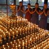 Tibetan Buddhist nuns chanting evening prayers
