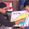 MAN ON THE STREET: Mengfei Li asks people to locate Asian countries on a map.