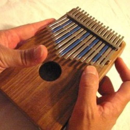 New Friend - Dr. Cornelius Pianeer Plays Thumb Piano